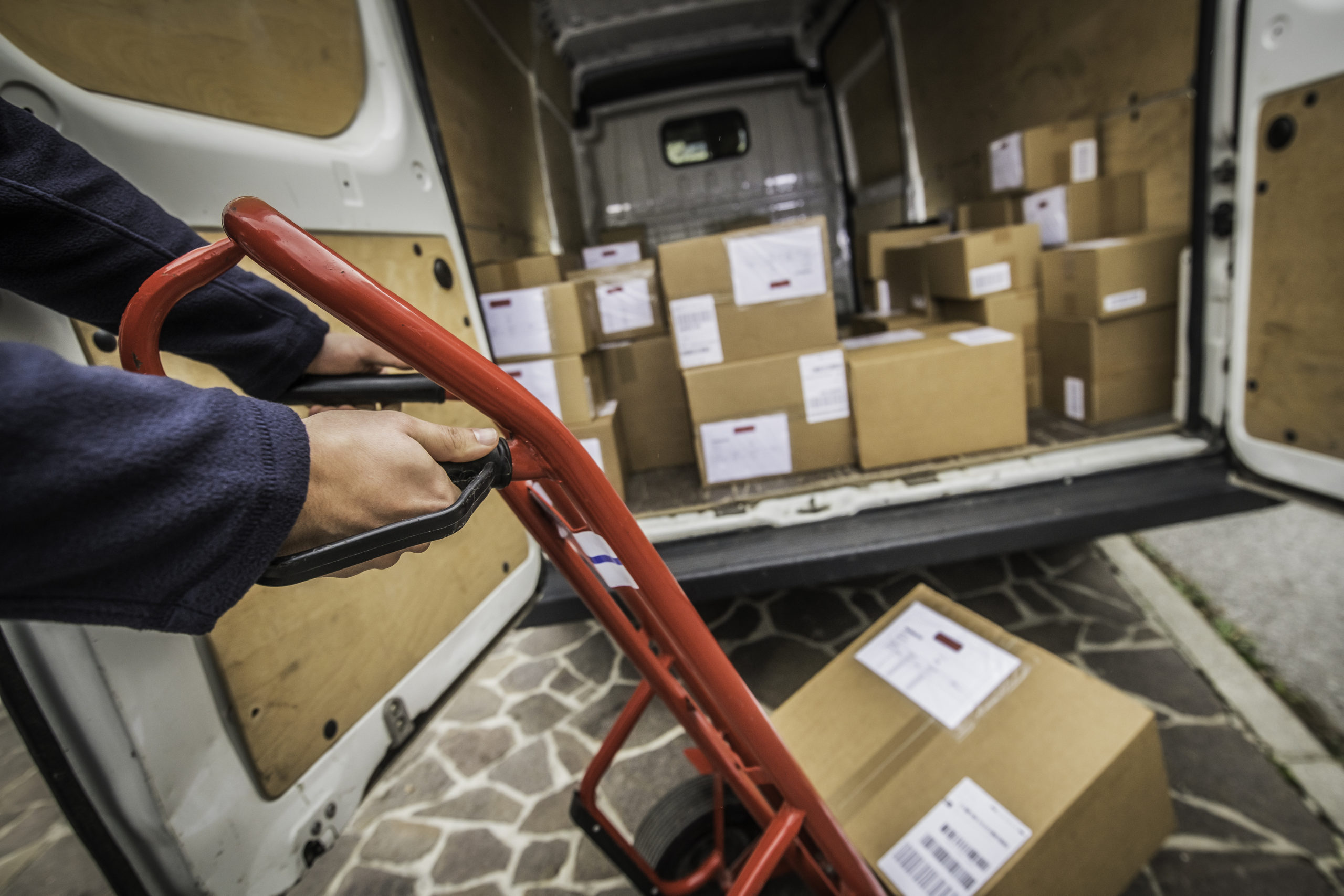 Loading a courier van